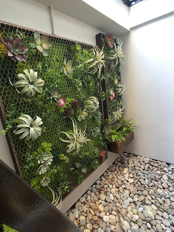 Vertical wall garden, Living wall, reclaimed wood, moss, succulents, ferns, air plants, planters, custom logos, office design, interior design, logo in moss, monogramed letter, ferns, Living room design,moss logo